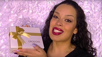 Adriana Pina, YouTube vlogger, holding the OROGOLD Box