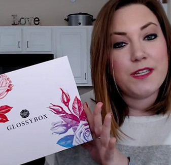 Emily from Rocky Mountain Savings holding the Glossybox Mother's Day Box.