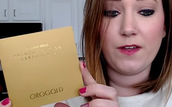 Emily holding the OROGOLD Authentication Certificate